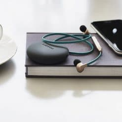 chrome wireless earphones on a book,on a table